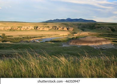 Milk River in Writing-On-Stone Provincial Park, Alberta, Canada with Sweetgrass Hills of Montana on the horizon.