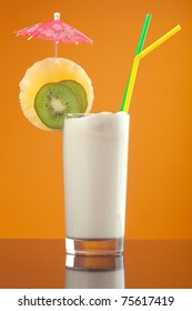 Milk shake  with chocolate and fruit on yellow background