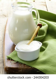 milk and sour cream on a wooden table, rustic style