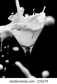 Milk splashing into a glass