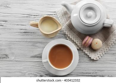 Milk tea with tea pot on white background.