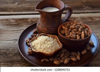 Сhufa milk and tigernut flour. Alternative type of milks. Vegan non-dairy milk. Lactose-Free Milk and Nondairy Beverages. Lactose intolerance. Gluten free. Grain free. Healthy food. Superfood.