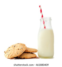 Milk in traditional bottle with chocolate chip cookies isolated on a white background