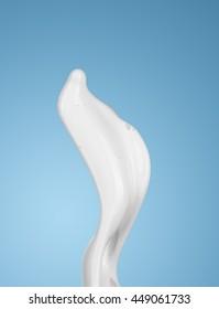 milk or white liquid splash on blue background. isolated
