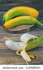 Milk yogurt with banana on the grey wooden background
