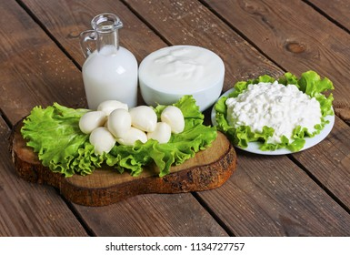 milk, yogurt, mozzarella and cheese with background - lactose free food
