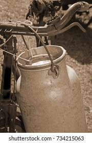 milkman old bicycle with can of milk and ancient sepia effect
