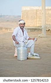 milkman selling milk in Rajasthan village 8-1-16
