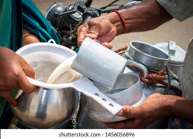Milkman supplying milk to customer in India