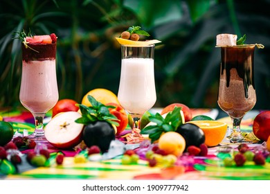 milkshake with berries and fruits on a decorated table