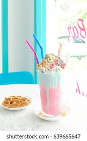 Milkshake. Bubblegum frappe in pink and blue theme, refreshment concept for birthday party serve. Window light