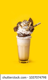 milkshake with cookies on a yellow background