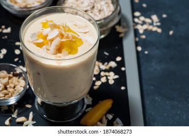milkshake with mango in a glass, closeup