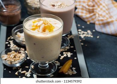milkshakes with chocolate and mango in glasses, horizontal