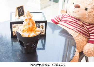 milktea ice shave with bread and chocolate toping on the table