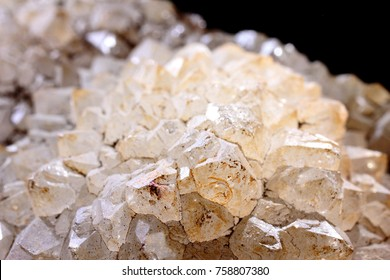 Milky translucent formations of quartz in front with black in background