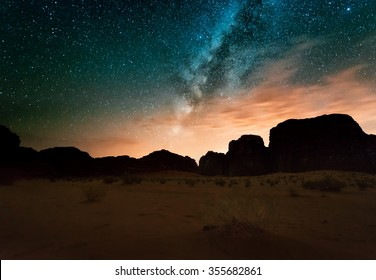 Milky way above red Wadi Rum desert in Jordan.