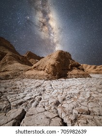 Milky Way above a stone formation in the amazing Atacama Desert, Chile