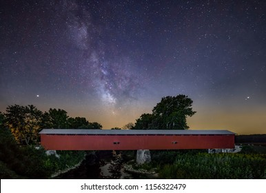 The Milky Way adorns the night sky over Houck Covered Bridge crossing Big Walnut Creek in rural Putnam County, Indiana.