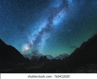 Milky Way. Amazing scene with himalayan mountains and starry sky at night in Nepal. High rocks with snowy peak and sky with stars. Beautiful Manaslu, Himalayas. Night landscape with bright milky way