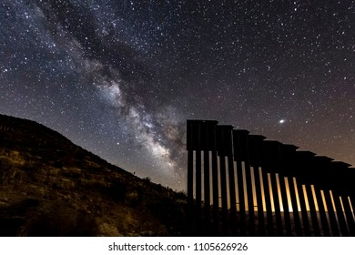 The Milky Way appears through a gap in the international border wall in San Diego County.