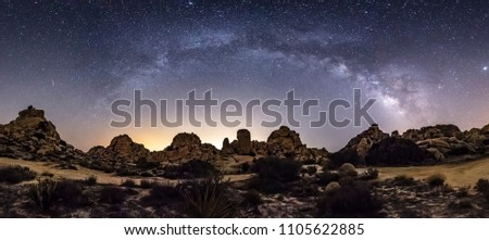 Milky Way Arch Panorama Over Valley Of The Moon in the desert of San Diego County, California.  A small meteor can be seen to the left of the Milky Way and the Andromeda galaxy (M31) to the right.