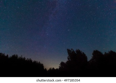 The Milky Way. A beautiful August summer night sky with stars. Starfall, the falling Perseids. Background