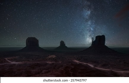 Milky Way and bright stars above Monument Valley. USA