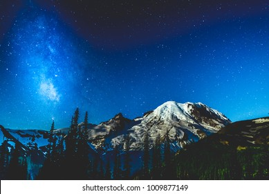 Milky Way competes with the moon for attention over Mt. Rainier.