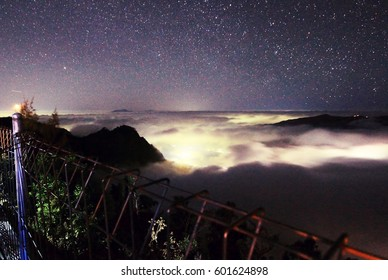 The milky way core rises above, taken from mountain in Bromo, Surabaya, Indonesia.  Image has grain or blurry or noise and soft focus when view at full resolution. (Shallow DOF, slight motion blur)
