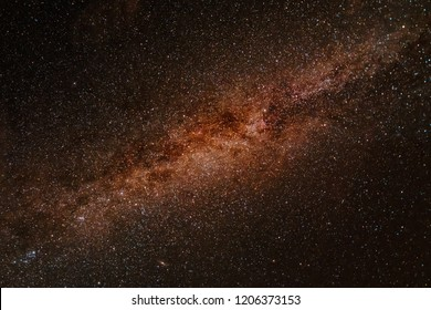 Milky way exposed in great detail and in brown reddish color, looks like space