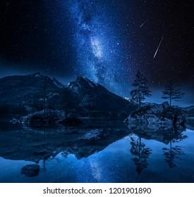 Milky way and falling stars at Hintersee lake, Alps, Germany