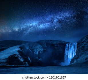 Milky way and falling stars over Skogafoss waterfall in Iceland