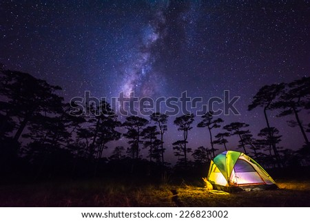 the milky way in front of a tent