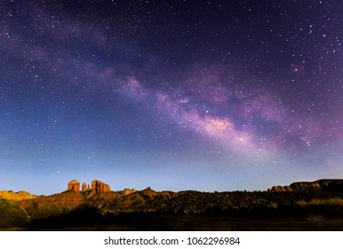 The Milky Way Galaxy arches across the night sky above Cathedral Rock in Sedona, Arizona.