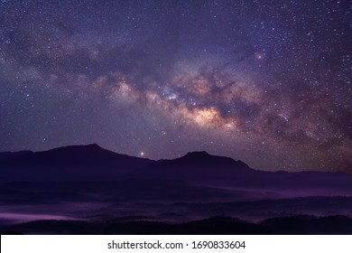 Milky way galaxy at mountain with stars and space dust in the universe, long speed exposure, Night landscape with colorful Milky Way, Starry sky with hills, Beautiful Universe, Space background.