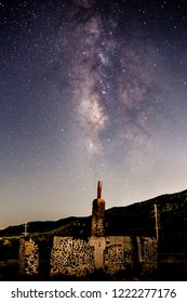 Milky Way galaxy over the remains of an abandoned building in San Diego County
