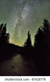 Milky way galaxy over the river and dark forest