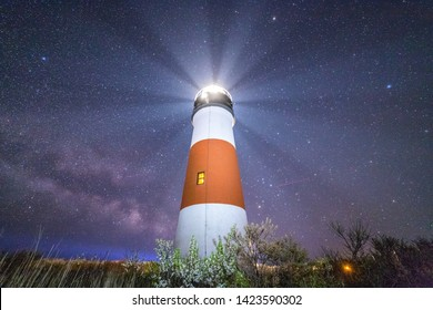 The Milky Way galaxy rising behind the classic Nantucket lighthouse.