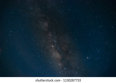Milky way galaxy with stars and space dust in the universe long exposure  with grain