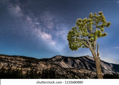 The Milky Way Galaxy stretches across the night sky over a great moonlit granite monolith know as Clouds Rest as seen from Olmsted Point in the high country of California's Yosemite National Park.