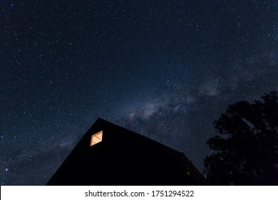 Milky Way and house silhouette.