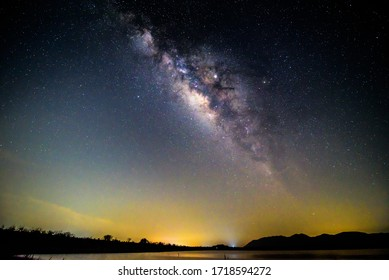 milky way at the lake in night time