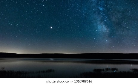 Milky way, Mars and the stars above Charpal lake in the Margeride area of Lozère on a warm summer night, away from light pollution.