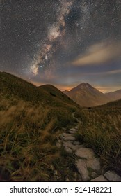 Milky way in mountain with a hiking path