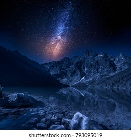Milky way at the mountains lake at night, Poland, Europe