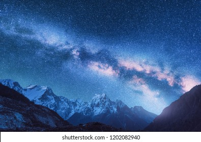 Milky Way and mountains. Space. Fantastic view with mountains and starry sky at night in Nepal. Mountain valley and sky with stars. Beautiful Himalayas. Night landscape with bright milky way. Galaxy