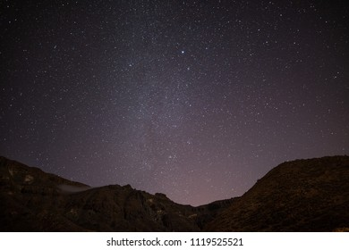 Milky Way. Night sky with shiny stars above mountain Roques de Garcia stone. Night in the Teide National Park, Tenerife, Canary Islands, Spain. Space background
