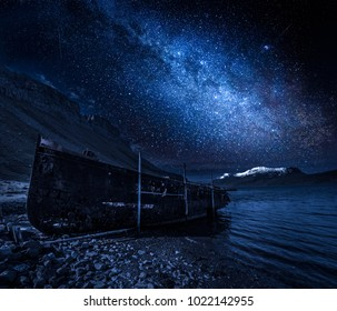 Milky way and old ship wreck at night, Iceland