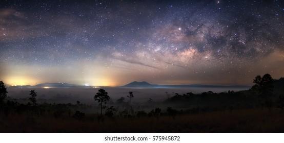 Milky way on mountain with mist field. Night sky
